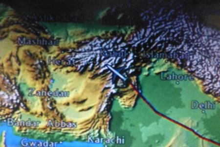 High above the RPGs, the plane flies over the tribal areas of Pakistan's northwest frontier.