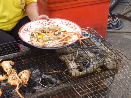 Street food in Thailand: the prawn assembly line.