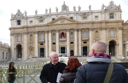 A cardinal escapee makes his exit from St. Peter's square. Buon Lavoro! shouts a woman, praising the results of the conclave.