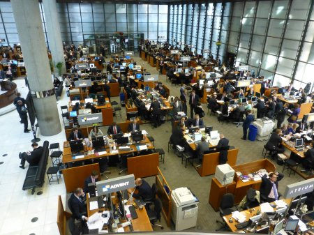 The Lloyd's Market trading floor. The chairs where the brokers sit and present their case to the underwriter are at the side of the main desks.