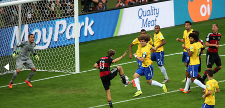 Brazil becomes prime meat for the Germans, who defeated them 7-1. The ad inthe back is er... unfortunate.