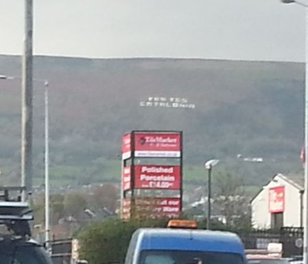 A sign promotes the devolution of Catalunya on the mountains east of Belfast.