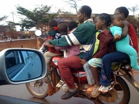 This seems to be too upmarket for my definition of boda-boda, but it's an exercise to count the passengers.