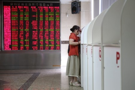 Although red in a lucky color in the Middle Kingdom, neither the big board or the woman's blouse seem to match her body language (picture from the Washington Post).