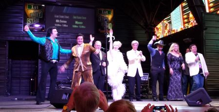 Celebrity clones take a bow after performing on Fremont Street. Neil Diamond and Elvis rub shoulders with Sinatra and Lady Gaga, introduced by Robin Williams.
