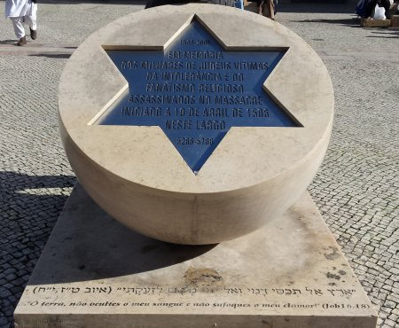 Downtown lisbon - the monument to Jews burnt at the stake to exorcise the plague.