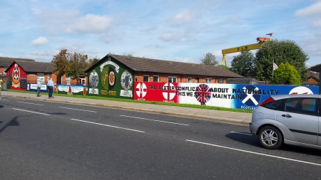 Murals at Freedom corner, East Belfast. The everpresent H&W gantry dominates the skyline.